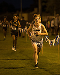 Daniel Horner (14) runs for the Nevada Men's Cross Country team as they compete for the first time in 25 years in the Bonanza Casino Nevada Twilight Classic season opener at Mira Loma Park in Reno on Friday night, August 30, 2019.