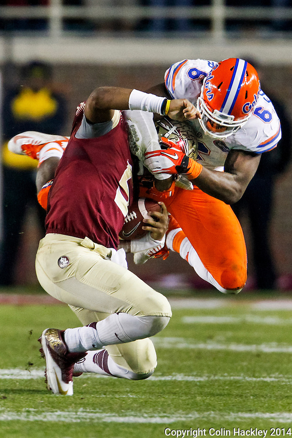 TALLAHASSEE, FL 11/29/14 FSU-UF112914-Florida State quarterback Jameis Winston is tackled by the University of Florida's Dante Fowler, Jr. during fourth quarter action Saturday at Doak Campbell Stadium in Tallahassee. The Seminoles beat the Gators 24-19.<br /> COLIN HACKLEY PHOTO