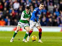 5th February 2020; Ibrox Stadium, Glasgow, Scotland; Scottish Premiership Football, Rangers versus Hibernian; Paul McGinn of Hibernian  and Ryan Kent of Rangers compete for possession of the ball