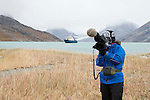 A videographer captures some footage in Eastern Greenland. The videographer is part of the Cape Farewell Youth Expedition that was organized by the British Council of Canada.