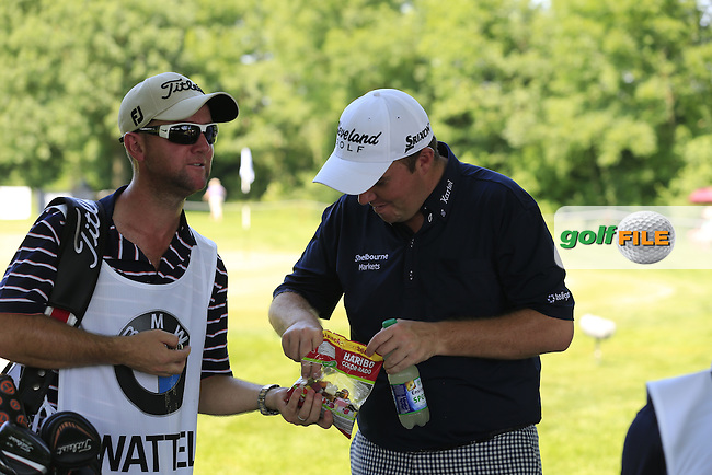 Shane Lowry (IRL) takes a break in the shade at the 10th green from the oppressive heat during Thursday's Round 1 of the 2013 BMW International Open held on the Eichenried Golf Club, Munich, Germany. 20th June 2013<br /> (Picture: Eoin Clarke www.golffile.ie)