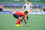 The Hague, Netherlands, June 10: Jonghyun Jang #25 of Korea stops the ball during the field hockey group match (Men - Group B) between Germany and Korea on June 10, 2014 during the World Cup 2014 at Kyocera Stadium in The Hague, Netherlands. Final score 6-1 (3-0) (Photo by Dirk Markgraf / www.265-images.com) *** Local caption ***