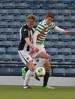 Blair Henderson (left) and Stuart Findlay tussle in the Dunfermline Athletic v Celtic Scottish Football Association Youth Cup Final match played at Hampden Park, Glasgow on 1.5.13. .
