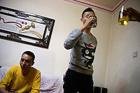 Friends toast the Chinese New Year in an apartment in Pingliang, Gansu Province, China.