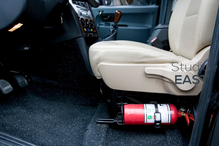 The driver's seat of a 'black cab' includes a handy fire extinguisher, in Shanghai, China, on March 23, 2009.  London Taxi International, the producer of London Taxi's famed black cabs, turned to China to drive overseas expansion. More than 8,000 London Taxis will be produced from the Chinese factory, more than double the annual output of the firm's historical factory plant in Conventry, England. Most of these cars will go to places like Singapore, Dubai, Moscow, that covet the image associated with the London Taxis' tradition of good service and durability. London Taxi International will continue to build 90 percent of the Taxi cabs used in Britain at Coventry. Photo by Lucas Schifres/Pictobank