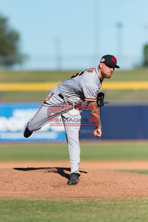 Scottsdale Scorpions relief pitcher Sam Wolff (56), of the San Francisco Giants organization, follows through on his delivery during an Arizona Fall League game against the Peoria Javelinas at Peoria Sports Complex on October 18, 2018 in Peoria, Arizona. Scottsdale defeated Peoria 8-0. (Zachary Lucy/Four Seam Images)