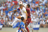 Alvaro Saborio (9) of Costa Rica goes against Jose Mendoza (1) of Honduras.  Honduras defeated Costa Rica 1-0 at the quaterfinal game of the Concacaf Gold Cup, M&T Stadium, Sunday July 21 , 2013.