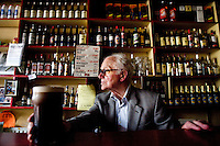 90 year old Tom Frawley runs P. Frawley's bar the last traditional bar in the booming coastal town of Lahinch County Clare, Ireland. The bar only has one tap and thats Guinness (the best pint around). Tom has one eye and says he hasn't been married yet. He was born in the bar and has lived there all his life. <br /> Picture James Horan