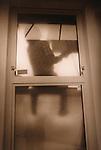 worker seen through door window