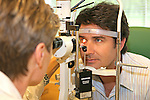 Ophthalmologist examining patient