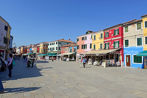 Main retail street in Burano, Italy showing the colorful facades of the buildings on April 15, 2013.  .Credit: Ron Sachs / CNP