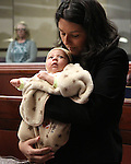 Nevada Assemblywoman Olivia Diaz, D-North Las Vegas, holds her son Xavier Alejandre during the prayer on the Assembly floor on April 18, 2011, at the Legislature in Carson City, Nev. .Photo by Cathleen Allison