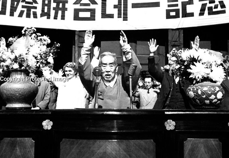 The Hon. S.Y. Lee, Vice President of South Korea, leads cheers at the close of the UN Day ceremony at Seoul.  October 24, 1950.  Sgt. Ray Turnbull.  (Army)<br /> NARA FILE #:  111-SC-35191<br /> WAR &amp; CONFLICT BOOK #:  1379