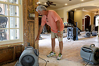 NWA Democrat-Gazette/DAVID GOTTSCHALK Jeff Fenwick displays the water level inside his home Tuesday, June 4, 2019, on a stripped wall on Turtle Bay Drive in Fort Smith. Residence in the neighborhood are beginning the process of recovering following flooding by the Arkansas River.