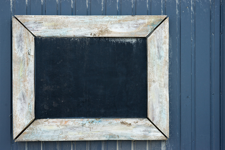 Copy space on a vintage blackboard to write your own text