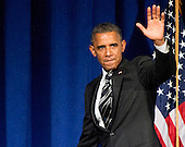 United States President Barack Obama waves to supporters as he departs the stage following his remarks at a campaign event at the Capital Hilton Hotel in Washington, D.C. on Friday, September 28, 2012..Credit: Ron Sachs / Pool via CNP