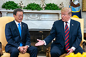 US President Donald J. Trump (R) welcomes Korean President Moon Jae-in (L) to the Oval Office of the White House in Washington, DC, USA, 11 April 2019. President Moon is expected to ask President Trump to reduce sanctions on North Korea in an attempt to jump start nuclear negotiations between North Korea and the US.<br /> Credit: Jim LoScalzo / Pool via CNP