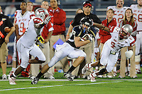 6 December 2008:  FIU wide receiver Greg Ellingson (82) attempts to evade Western Kentucky defensive back Trent Calhoun (47) and linebacker Taurean Smith (41) in the third quarter of the FIU 27-3 victory over Western Kentucky at FIU Stadium in Miami, Florida.