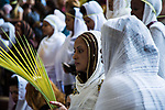 Egyptian Orthodox Christians take part in a mass marking the Palm Sunday at a church in Saint Samaan the tanner Monastery in Cairo on April 1, 2018. Photo by Stringer