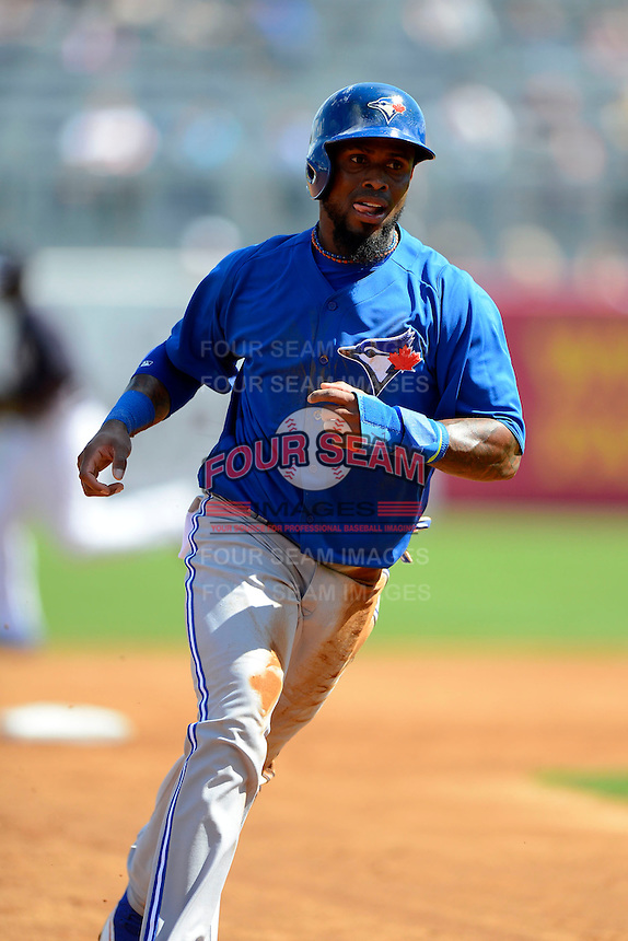 Toronto Blue Jays shortstop Jose Reyes #7 rounds third during a Spring Training game against the New York Yankees at Steinbrenner Field on February 28, 2013 in Tampa, Florida.  Toronto defeated New York 1-0.  (Mike Janes/Four Seam Images)