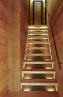 Concealed spotlights behind each tread make a feature of this open staircase