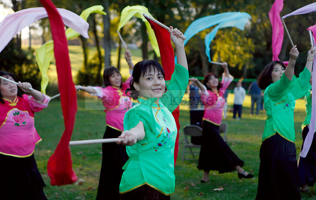 The KYCAA dance team performs the ribbon dance during the Moon Festival Celebration at Shillito Park on Saturday, October 3, 2009. Photo by Zach Brake | Staff