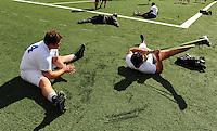 Jun. 13, 2009; Las Vegas, NV, USA; Players stretch on field prior to the United Football League workout at Sam Boyd Stadium. Mandatory Credit: Mark J. Rebilas-