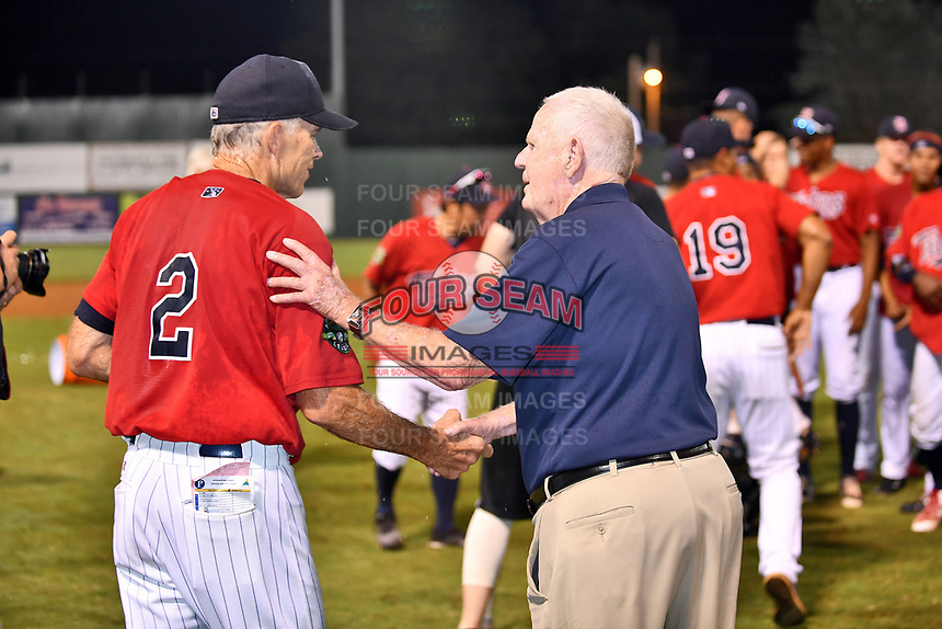 Appalachian League president Lee Landers congratulates Elizabethton Twins manager Ray Smith (2) after the Twins won the Appalachian League Championship Series against the Princeton Rays 2-1 at Joe O'Brien Field on September 5, 2018 in Elizabethton, Tennessee. (Tony Farlow/Four Seam Images)