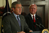 United States President George W. Bush, left, announces he has selected Samuel Bodman to be US Secretary of the Department of Energy. The announcement was made in the Roosevelt Room of the White House on December 10, 2004. <br /> Credit: Dennis Brack / Pool via CNP
