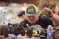 NWA Democrat-Gazette/BEN GOFF @NWABENGOFF<br /> Matt Kuhel of Frontenac, Kan. works on one of his 1/10-scale electric radio control race cars on Sunday Nov. 29, 2015 at NWA R/C Raceway in Rogers. The shop holds races most weekends for a variety of types of 1/10-scale electric vehicles on two indoor tracks.