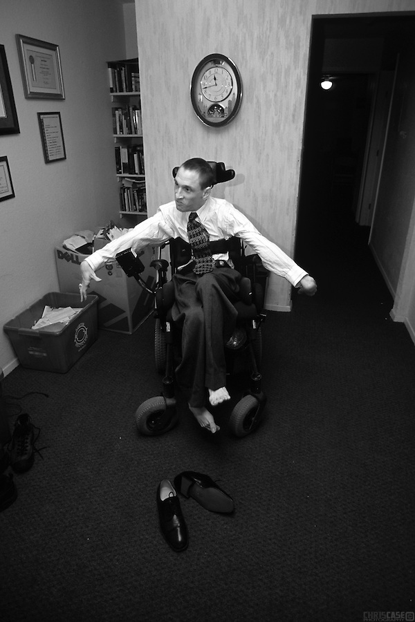 Sean Pevsner waits for his assistant, Michael Galante, to finish dressing him for an interview. <br /> <br /> Sean Pevsner was born with severe cerebral palsy. He is in his final year of law school at the University of Texas.