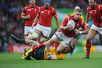 Gareth Anscombe of Wales is brought down by Sean McMahon of Australia during Match 35 of the Rugby World Cup 2015 between Australia and Wales - 10/10/2015 - Twickenham Stadium, London<br /> Mandatory Credit: Rob Munro/Stewart Communications