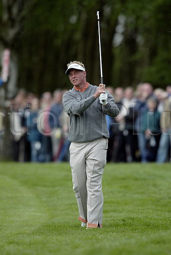 7 May 2004: Northern Irish golfer Darren Clarke looks into the distance after playing an iron from the light rough during the second round of the Daily Telegraph Damovo British Masters played at the Marriott Forest of Arden, Birmingham. Photo: Neil Tingle/Action Plus..040507 golf golfer golfers