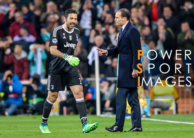 Goalkeeper Gianluigi Buffon of Juventus (L) walks pass Manager Massimiliano Allegri of Juventus (R) after been sent off during the UEFA Champions League 2017-18 quarter-finals (2nd leg) match between Real Madrid and Juventus at Estadio Santiago Bernabeu on 11 April 2018 in Madrid, Spain. Photo by Diego Souto / Power Sport Images