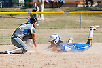 Western Nevada's Gabriella Canibeyaz (9) is tagged out at second base by Salt Lake Community College's Karly Bunderson (22) during the first game of a two game series in Carson City, Nev. on Saturday, March 7, 2015. <br />