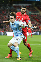 David Silva of Manchester City and Emre Can of Liverpool during the Capital One Cup match between Liverpool and Manchester City at Wembley Stadium, London, England on 28 February 2016. Photo by David Horn / PRiME Media Images.