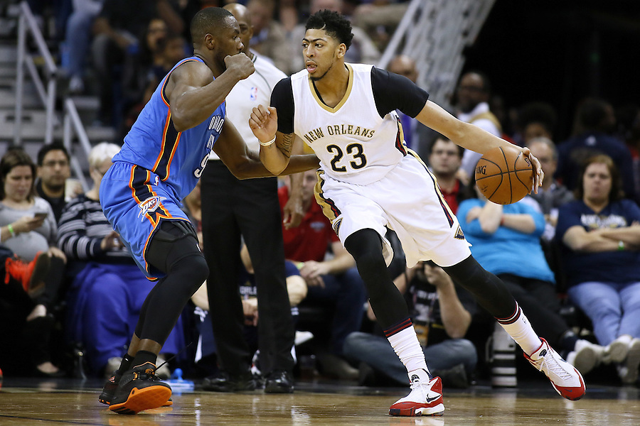 New Orleans Pelicans forward Anthony Davis (23) drives against Oklahoma City Thunder forward Serge Ibaka (9) during the second half of an NBA basketball game Thursday, Feb. 25, 2016, in New Orleans. The Pelicans won 123-119. (AP Photo/Jonathan Bachman)