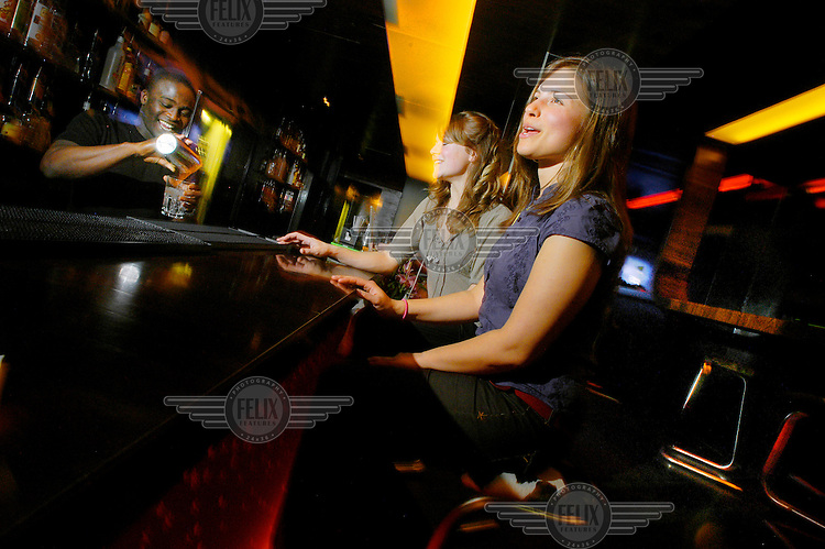 Young Londoners having fun in the Lucky Voice Karaoke Bar in Soho.