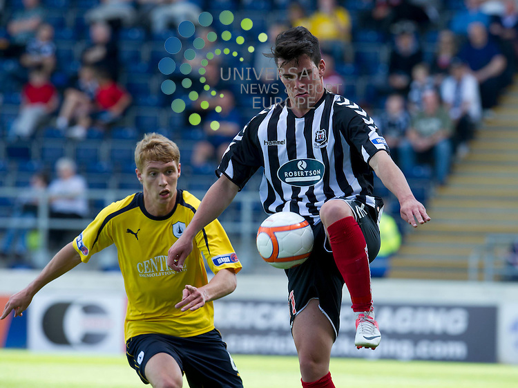 Jay Fulton of Falkirk challenges for the ball against Daniel Moore of Elgin City during the Communities League Cup first round match between Falkirk and Elgin City at The Falkirk Stadium. 4 August 2012. Picture by Ian Sneddon / Universal News and Sport (Scotland). All pictures must be credited to www.universalnewsandsport.com. (Office) 0844 884 51 22.