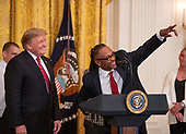 Gregory Allen, who served more than eight years in prison  makes remarks as United States President Donald J. Trump looks on during the 2019 Prison Reform Summit and First Step Act Celebration in the East Room of the White House in Washington, DC on Monday, April 1, 2019.<br /> Credit: Ron Sachs / CNP