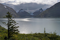 Rain falls over Portage lake and the Chugach mountains, Alaska.