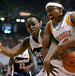 KNOXVILLE, TN--07 JANUARY 2005- 010706JS08-<br /> UConn's Charde Houston and Tennessee's Alexis Hornbuckle battle for a loose ball during their game Saturday at the Thompson-Boling Arena in Knoxville, Tennessee. <br />  --Jim Shannon Republican American--UConn; Tennessee; Thompson-Boling Arena; Knoxville; Tennessee, Charde Houston, Alexis Hornbuckle are CQ
