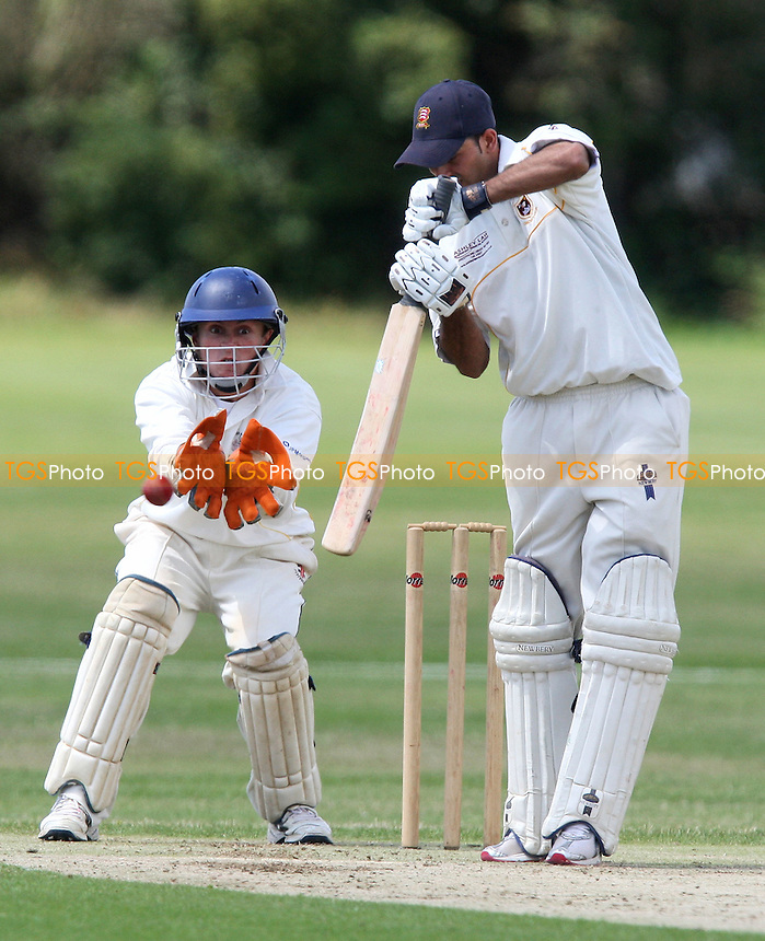 A Zafar of Hainault in batting action as C Swainland looks on from behind the stumps - Hainault & Clayhall CC vs Gidea Park & Romford CC - Essex Cricket League - 19/07/08 - MANDATORY CREDIT: Gavin Ellis/TGSPHOTO - Self billing applies where appropriate - Tel: 0845 094 6026.