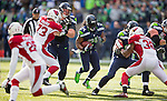 Seattle Seahawks running back Marshawn Lynch (24) looks for an opening against  Arizona Cardinals defenders Josh Mauro (73) and Antonio Cromatie (31) at CenturyLink Field in Seattle, Washington on November 23, 2014. The Seahawks beat the Cardinals 19-3.  ©2014. Jim Bryant Photo. All Rights Reserved.