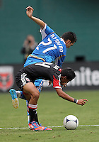 WASHINGTON, D.C. - AUGUST 19, 2012:  Andy Najar (14) of DC United battles for the ball with Michael Farfan (21) of the Philadelphia Union during an MLS match at RFK Stadium, in Washington DC, on August 19. The game ended in a 1-1 tie.