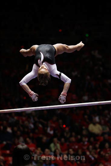 Trent Nelson  |  The Salt Lake Tribune.Salt Lake City - Utah's Kyndal Robarts on the bars, Utah vs. BYU college gymnastics Friday, March 26, 2010.