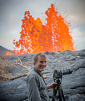 May 2018: A photographer stands close to the Kilauea Volcano eruption in Leilani Estates, Puna, Big Island of Hawai'i.