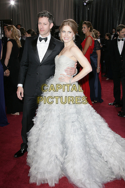 Darren Le Gallo & Amy Adams (wearing Oscar de la Renta).85th Annual Academy Awards held at the Dolby Theatre at Hollywood & Highland Center, Hollywood, California, USA..February 24th, 2013.oscars full length dress gown powdery blue fluffy layers layered feathery tulle train strapless hand on hip side tuxedo black white shirt married husband wife .CAP/ADM.©AdMedia/Capital Pictures.