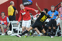 Manchester United forward Wayne Rooney (10) goes against FC Barcelona midfielder Sergio Busquets (16) Manchester United defeated Barcelona FC 2-1 at FedEx Field in Landover, MD Saturday July 30, 2011.