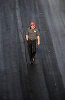 Sept. 17, 2010; Concord, NC, USA; NHRA team owner Alan Johnson surveys track conditions during qualifying for the O'Reilly Auto Parts NHRA Nationals at zMax Dragway. Mandatory Credit: Mark J. Rebilas/